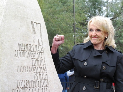 Gov. Jan Brewer as she unveils the Tenth Amendment monolith at the Arizona Bill of Rights dedication ceremony, Dec. 15, 2012 (photo: Arizona Attorney, Tim Eigo)