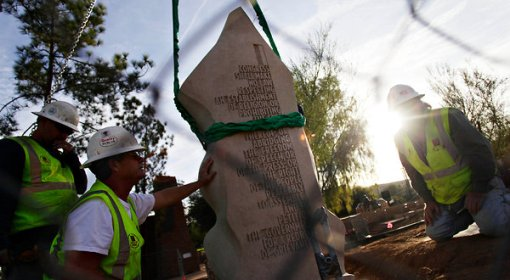 Workers prepared to install a limestone slab that is part of a monument to the Bill of Rights at the Arizona Capitol in Phoenix. It will be dedicated Saturday. (Joshua Lott for The New York Times)