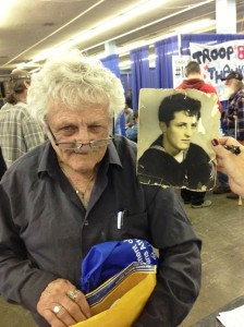 Veteran Edward Cook, alongside a photo of his younger self, at the 2013 Arizona StandDown. (photo: Alberto Rodriguez)