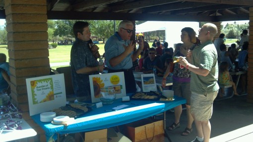 Picnic attendees chat with representatives from sponsor John Driscoll & Company.