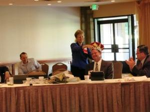 Bar President Amelia Craig Cramer crowns her successor, Whitney Cunningham, June 18, 2013.