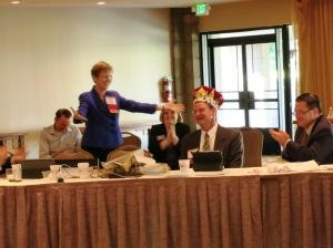 The reveal: Bar President Amelia Craig Cramer displays her crowned successor, Whitney Cunningham, June 18, 2013.