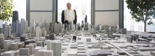 Howard Ecker gazes at a model of Chicago.