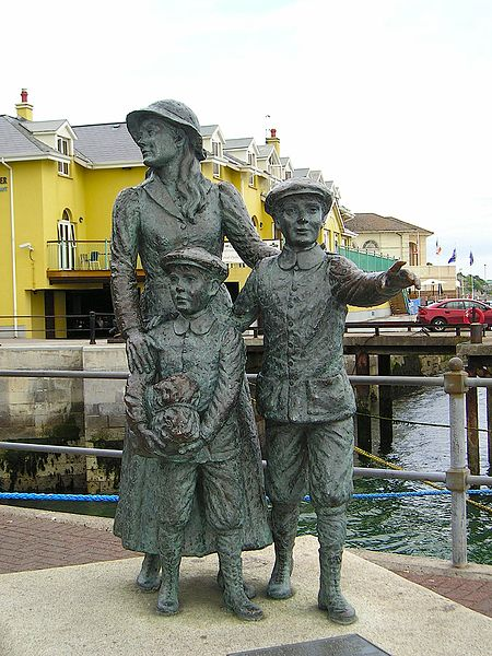 Immigrant Annie Moore and her brothers depicted at the harbor of Cobh, Ireland