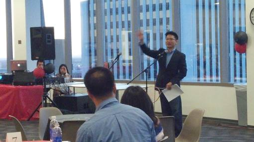 Jared Leung delivers the keynote address (with tennis racquet) at the APALSA banquet, April 5, 2014.