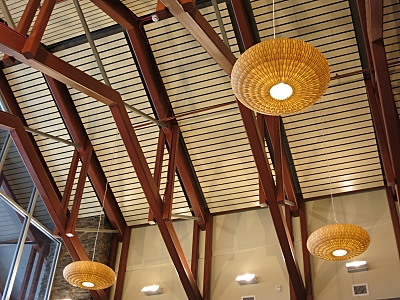 Basket-weaving, an important component of the Ak-Chin culture, is apparent in the Ak-Chin Justice Center's design and appointments. The photo shows how the design influences the light fixtures.