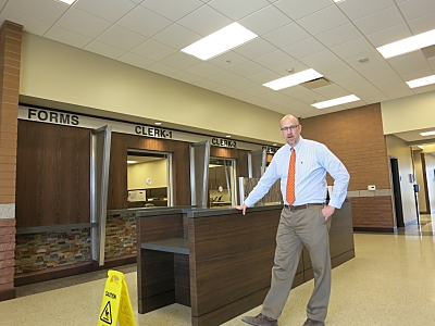 Tribal Judge Brian Burke describes features of the new courtroom space at the Ak-Chin Justice Center, June 5, 2014.