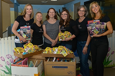 Members of the Gallagher & Kennedy Professional Women's Group who donated hundreds of books to children at Phoenix Day on Wednesday, May 28, 2014, as part of their role in the Valley of the Sun United Way's Million Minutes Volunteer Reading Challenge. L to R: Jodi Bohr, Jennifer Cranston, Lori Stinson (Phoenix Day), Laura Antonuccio, Meg Smeck, Alana Hake. (Photo: PatrickCorley.com)