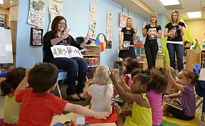 Gallagher & Kennedy attorney Laura Antonuccio reads to Phoenix Day schoolchildren, May 28, 2014.