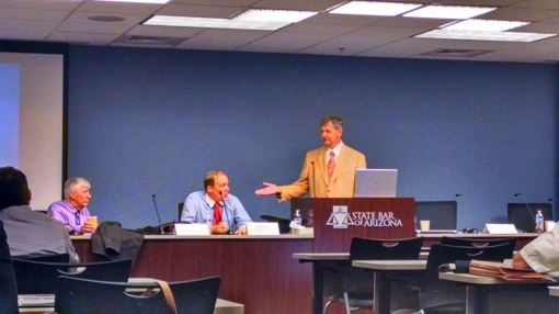 Judge George Anagnost moderates the We the People panel, Sept. 17, 2014. He gestures toward panelists Bob McWhirter and Doug Cole.