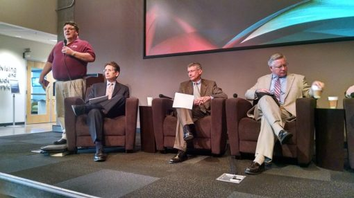 Mark Scarp introduces the panel, including (L to R) moderator David Bodney, Hon. Joseph Welty, Bill Montgomery.