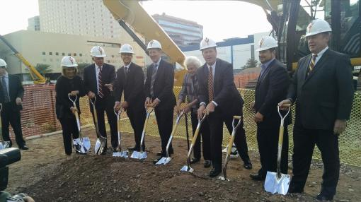 University leaders and dignitaries break ground at the ASU Center for Law & Society in downtown Phoenix, Nov. 13, 2014. Those pictured include law school Dean Doug Sylvester (third from left), retired Justice Sandra Day O'Connor and Phoenix Mayor Greg Stanton (center) and ASU President Michael Crow (right).