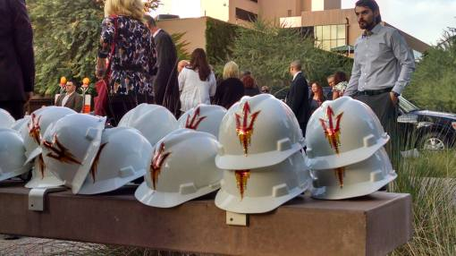 Fork-branded construction headgear awaits dignitaries at the ASU groundbreaking.