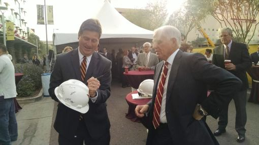 Phoenix Mayor Greg Stanton signs a construction helmet as attorney Leo Beus looks on, Nov. 13, 2014.