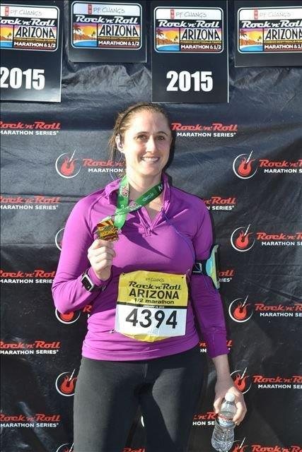 Attorney Jennison Cox showing off her well-earned heavy medal after a 1:50-ish half marathon.