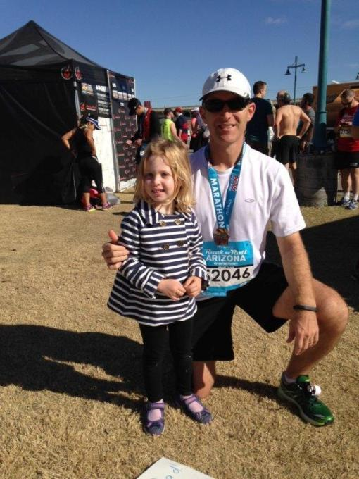 Bar Fly and attorney Stefan Palys with his daughter in the family reunion area after running the full marathon.