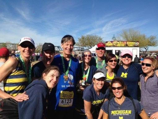 David Sandweiss with past members from different years of the Univ. of Michigan women's track team. They have their own alumni club and pick one event a year to have a running reunion. This year they chose the Arizona P.F. Chang's event. One of them, in her low 40s, finished third overall in the women's half marathon in 1:15. The guy in the red hat photobombed the group.
