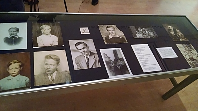 A display of photos of Andy Warhol as a boy and young man.