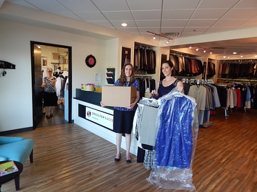 Gallagher & Kennedy associates Hannah Porter and Kimberly Allen pictured with a small selection of the clothing the firm's Professional Women's Group donated to Dress for Success.