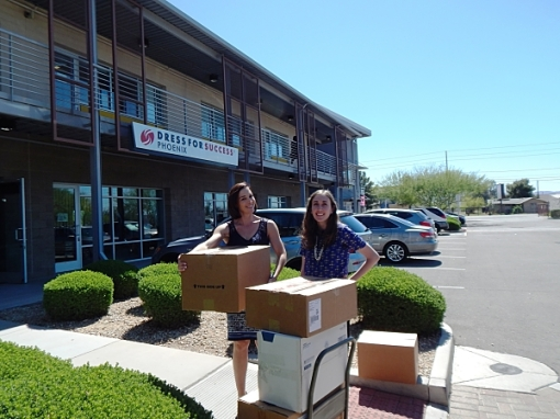 Kimberly Allen and Hannah Porter, associates with Gallagher & Kennedy, deliver donated items to Dress for Success, Phoenix.