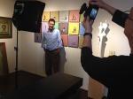 LarsenShoot3LR Attorney Mark Bockel poses in the Larsen Gallery, Scottsdale, as photographer John Hall shoots hispicture.