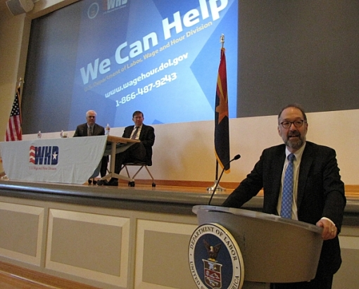 Dr. David Weil, Director of the Wage & Hour Division of the U.S. Department of Labor, speaks at the University of Arizona Medical School, Phoenix, April 1, 2015. On stage are Wage and Hour Division Phoenix District Director Eric Murray (at left) and Attorney Matt Meaker, who was also the event coordinator (Photo courtesy of the DOL Wage and Hour Division.)