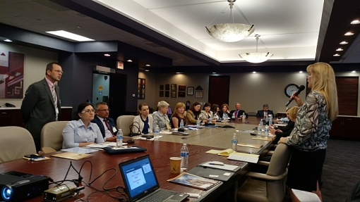 State Bar of Arizona Bar Counsel Amy Rehm addresses a delegation of Moldovan judges and lawyers, April 27, 2015, Phoenix, Ariz.