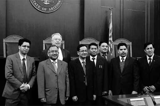 Arizona Office of the Courts Director David Byers (rear) with the delegates from Nepal, March 2015. Nepal Supreme Court Senior Justice Kalyan Shrestha is in the light-gray three-button suit in front of Mr. Byers.
