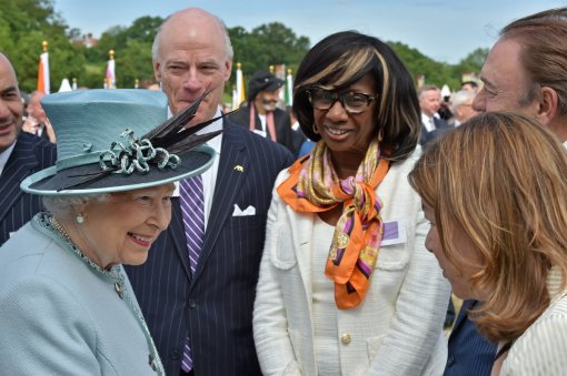 Trish Refo, right, greets Queen Elizabeth II.