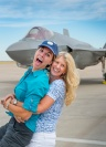 At ease: Photographer Karen Shell and Art Director Karen Holub celebrate a successful photo shoot in front of the F-35A Lightning II, July 9, 2015.