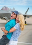 At ease: Photographer Karen Shell and Art Director Karen Holub celebrate a successful photo shoot in  front of the F-35A Lightning II, July 9,2015.