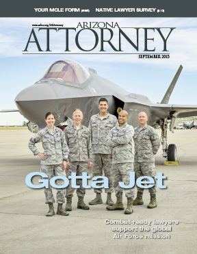 September 2015 Arizona Attorney: JAG lawyers stand in front of F-35 at Luke Air Force Base, Arizona. (Photo by Karen Shell)