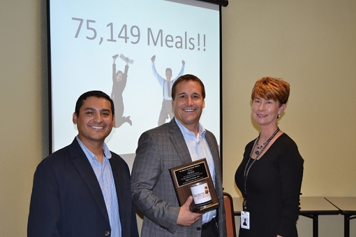 Richard Saldivar, principal of TERIS for Arizona and Texas (center), with Ernie Ortiz, food drive manager, St. Mary's Food Bank Alliance (left), and Beverly Damore, president and CEO, St. Mary's Food Bank Alliance, in the inaugural Object to Hunger Food Drive in 2013.