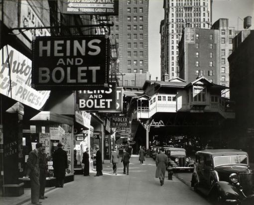 """This was the """"Radio Row"""" neighborhood of Manhattan in 1936. The streets didn't look much different when they were transformed decades later to make way for the World Trade Center (photo via Wikimedia by Berenice Abbott)."""
