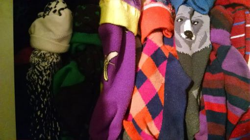 A sampling of socks gaze out from a portion of my drawer (yes, there are more socks).