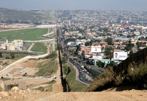 Border fence separating Mexico and United States.