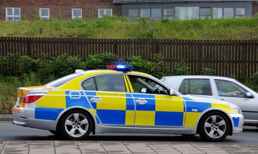 "British police car in its high-visibility ""checkered livery."" And it's not just loud on the eyes."
