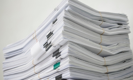 Pile of documents stack up high waiting to be managed