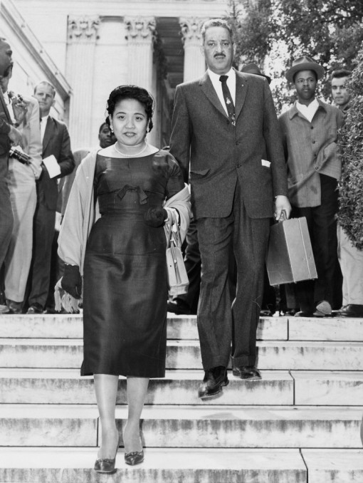 Thurgood Marshall, who led the NAACP's legal team, and his wife, Cecilia, leave the Supreme Court after the high court ordered the Little Rock School Board to proceed with integration at Central High School. (UPI)