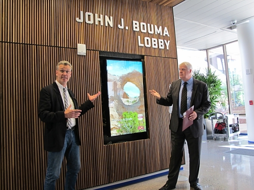 Tomas Rossant, Ennead Architects, and Tom Williams, ASU, demonstrate an interactive screen in the ASU Beus Center for Law & Society, Aug. 10, 2016.